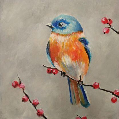 kék madár ül az ágon