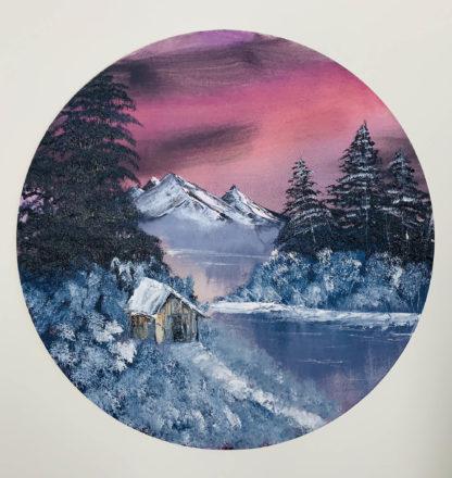 Kör alakú téli tájkép házikóval