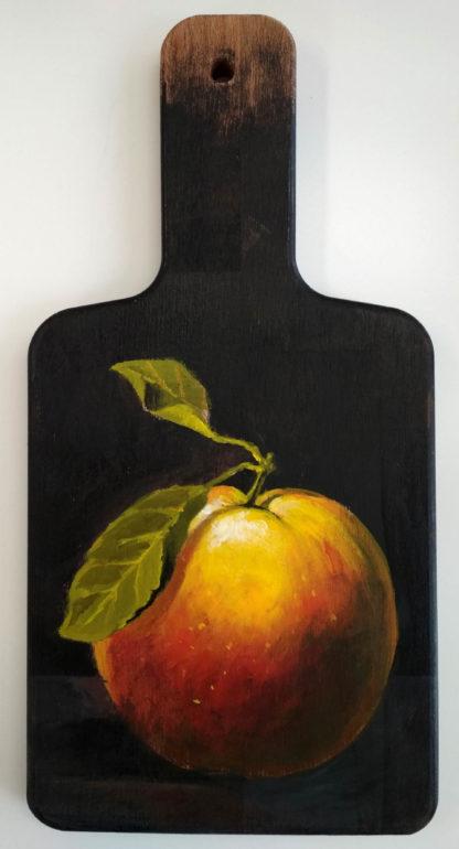 vágódeszkára festett alma