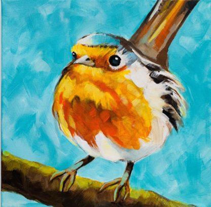 Sárga madár áll az ágon