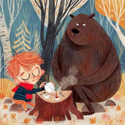 kisfiú és maci piknikezik